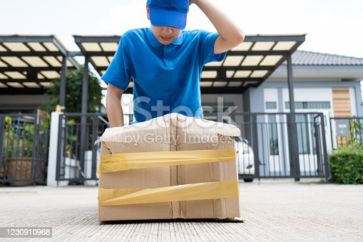115872043 istock photo Delivery man Frightened with cardboard box damaged broken accident before delivering to customers at home, Express service client online shopping comfortable payment package product. 1230910968