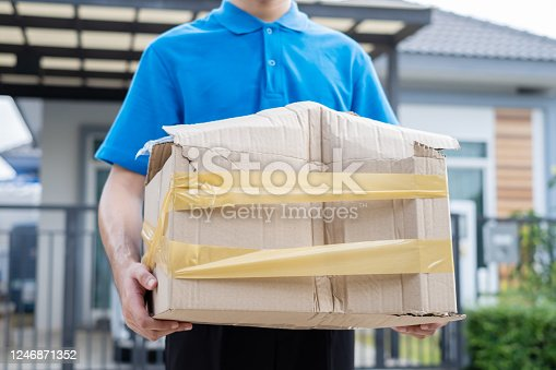 115872043 istock photo Delivery man Frightened with cardboard box damaged broken accident before delivering to customers at home, Express service client online shopping comfortable payment package product. 1246871352