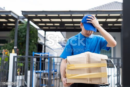 115872043 istock photo Delivery man Frightened with cardboard box damaged broken accident before delivering to customers at home, Express service client online shopping comfortable payment package product. 1246872412