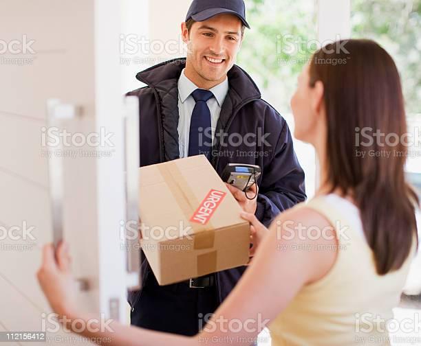 Delivery man handing box to woman picture id112156412?b=1&k=6&m=112156412&s=612x612&h= zbrkqdltjzv3ilmhtfous3qou9rd7fncq whtevtcm=