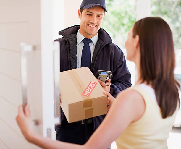 Delivery man handing box to woman picture id112156412?b=1&k=6&m=112156412&s=612x612&w=0&h=up8rtrw6g4utuvkhn2lhl 1rzcyvegjykgfcjw4necm=