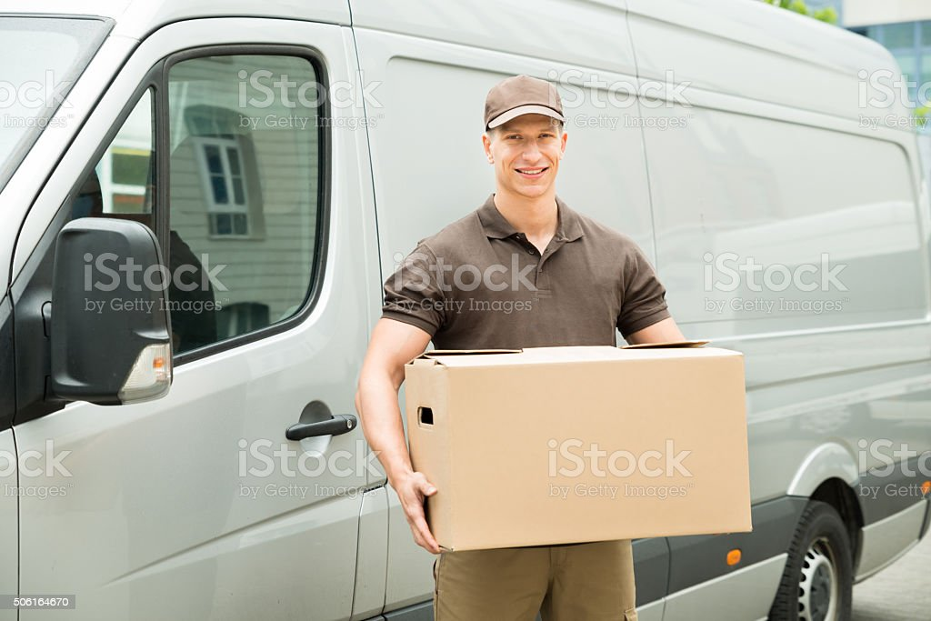 Delivery Man Holding Box stock photo