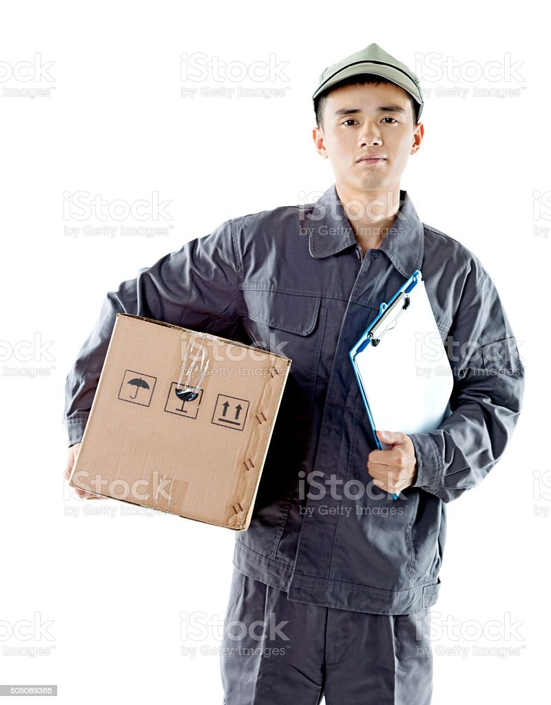 Delivery man holding cardboard box stock photo