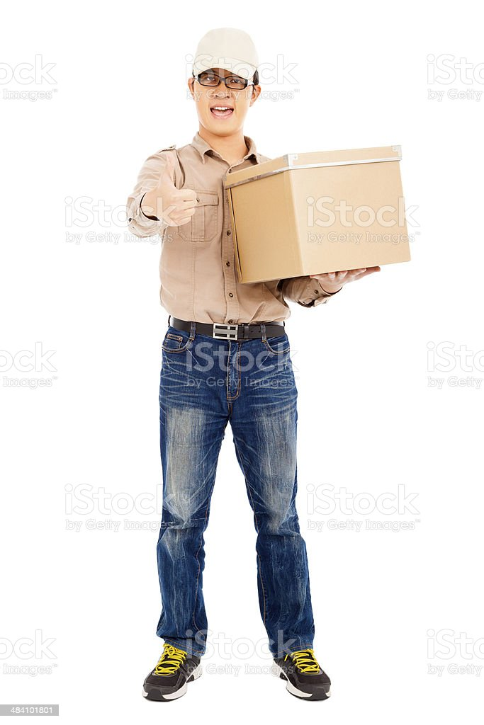 Delivery man holding goods and thumb up stock photo