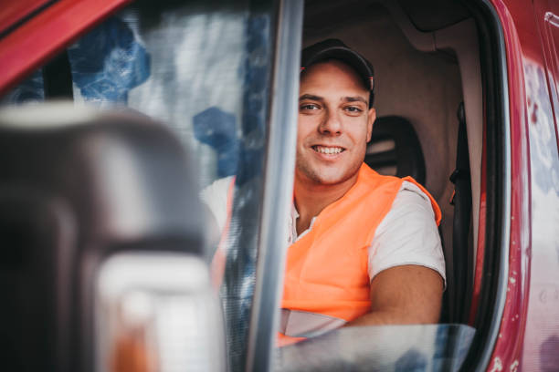 Delivery man in a van Delivery man in a van driver occupation stock pictures, royalty-free photos & images