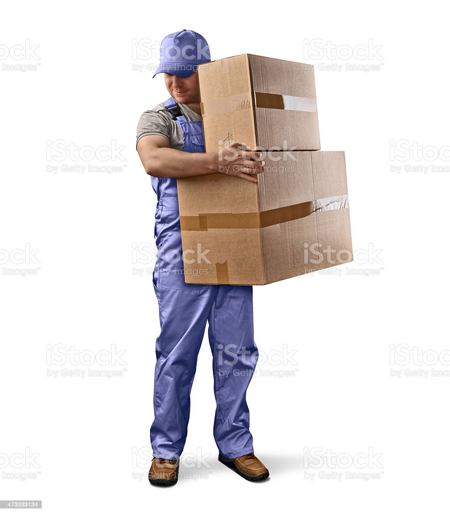 delivery man in blue uniform holding a box stock photo