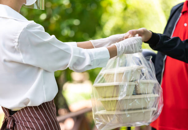Delivery man pick up food order stock photo