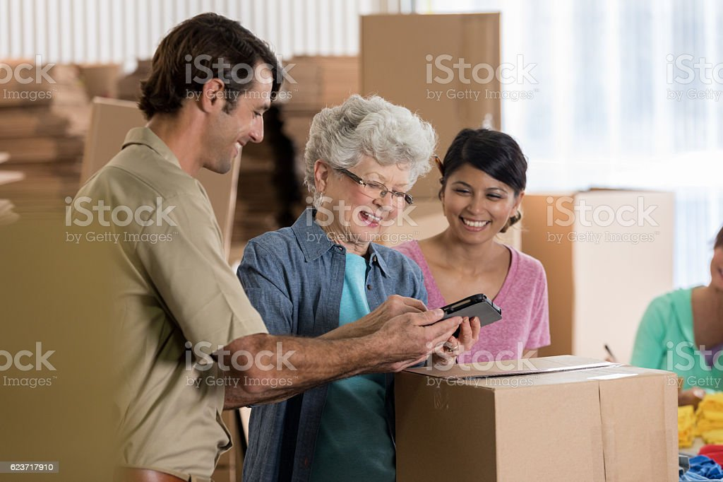 Delivery man picks up order at distribution warehouse stock photo