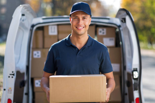 Delivery man Delivery man standing in front of his van delivery man stock pictures, royalty-free photos & images