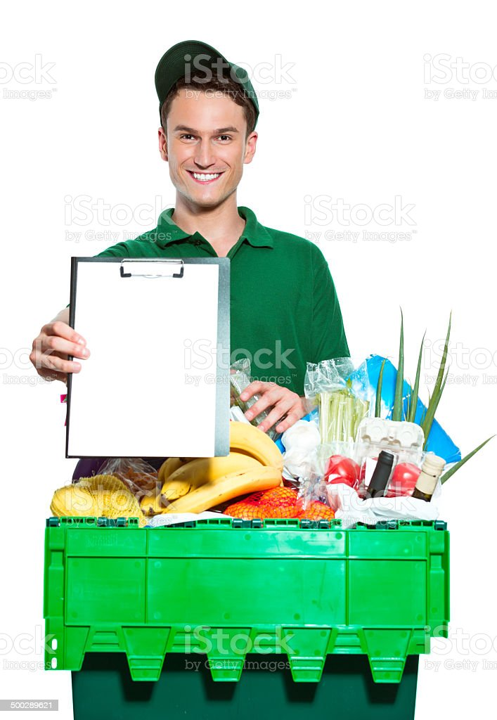 Delivery man Delivery man delivering box with groceries, holding clipboard in hand, smiling at the camera. Studio shot, white background. Adult Stock Photo