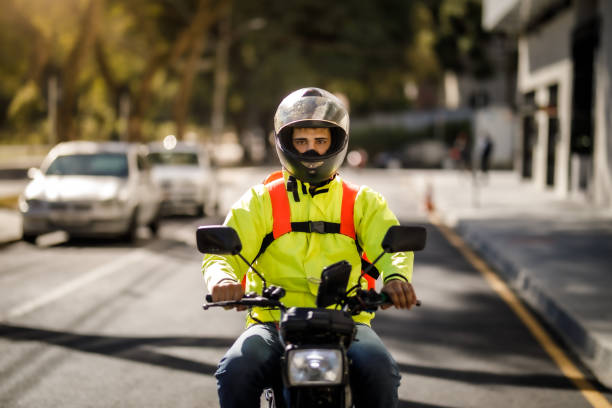 Delivery man riding a motorcycle - motoboy stock photo