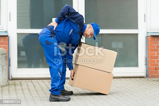 istock Delivery Man Suffering From Backpain 598555124