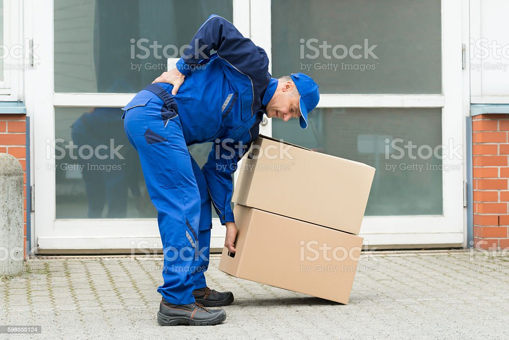 Delivery Man Suffering From Backpain stock photo