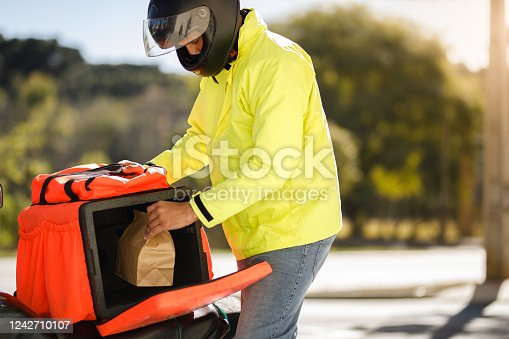 Delivery biker working.