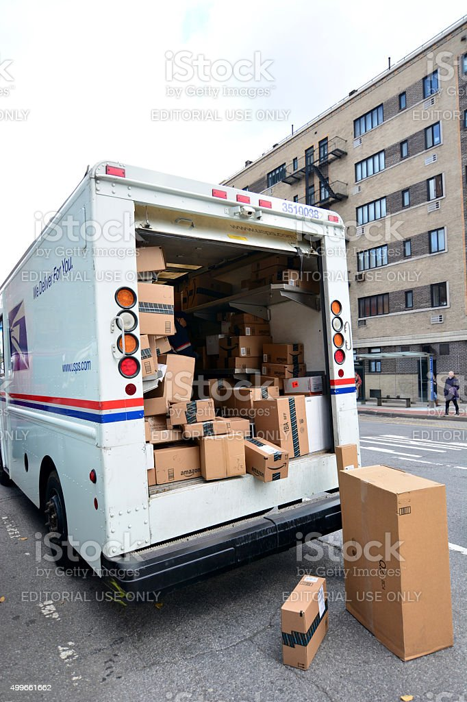 USPS Delivery man unloading boxes from truck stock photo