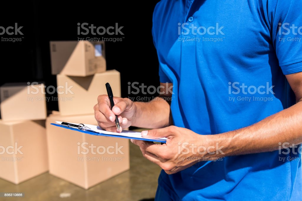 delivery man with documents stock photo