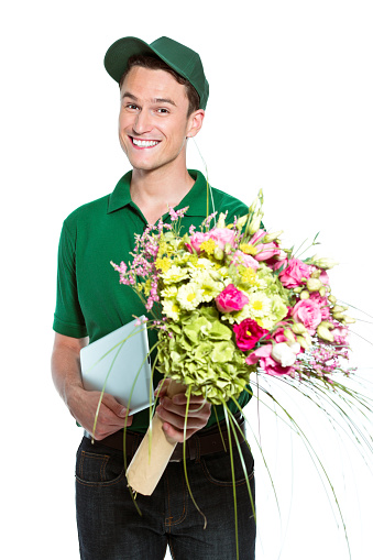 Delivery Man With Flowers Stock Photo - Download Image Now
