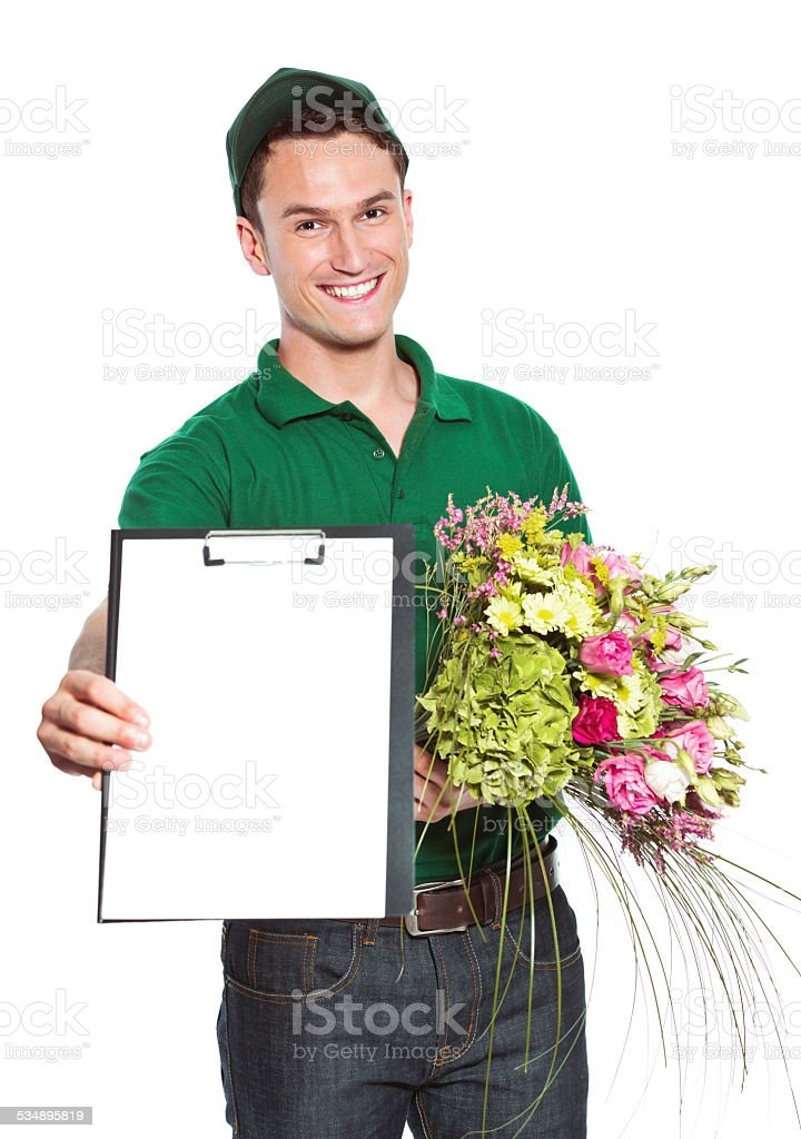 Delivery man with flowers Delivery man holding flowers and clip board, smiling at the camera. Studio shot, isolated on white. 2015 Stock Photo