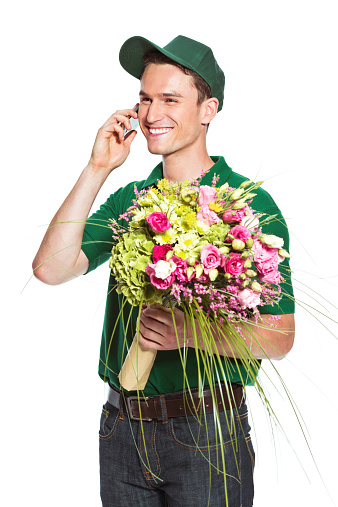 Delivery Man With Flowers Talking On Phone Stock Photo - Download Image Now