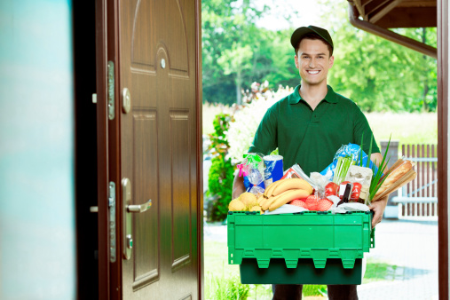 Delivery Man With Groceries Stock Photo - Download Image Now