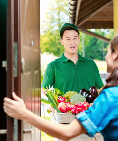 Delivery Man With Organic Food Stock Photo - Download Image Now