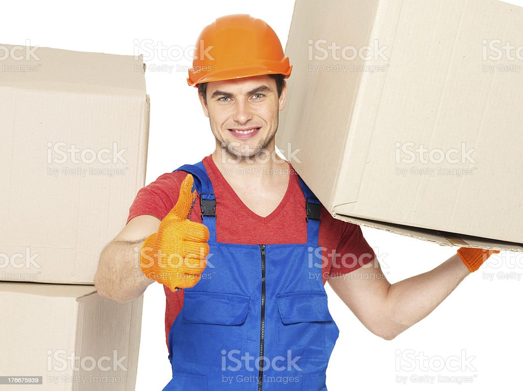 Delivery man with paper boxes and thumbs up sign royalty-free stock photo