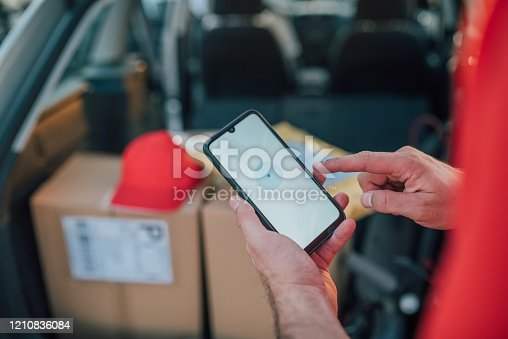 Postal worker checking his location using gps and the location of his customer