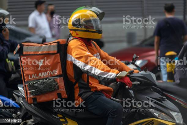 Delivery motorcyclist in traffic on the roads of makati picture id1206145479?b=1&k=6&m=1206145479&s=612x612&h=wh4ppxojoax1ohwfl8r7vzyq1 7pjxvhmhl1nr 19e4=