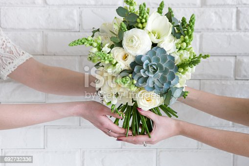 istock Delivery of bouquets from hand to hand 692732336