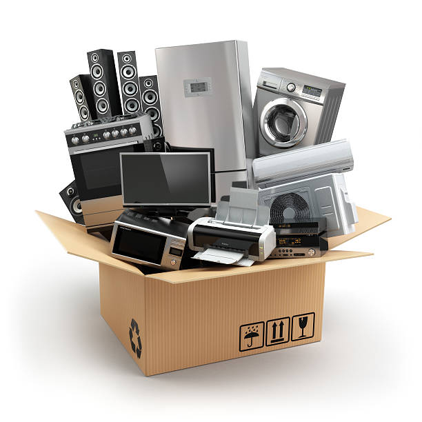 Delivery or moving concept. Home appliance in box. Fridge, washi stock photo