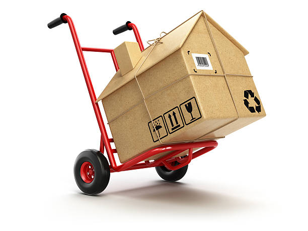 Delivery or moving houseconcept. Hand truck with cardboard box a stock photo
