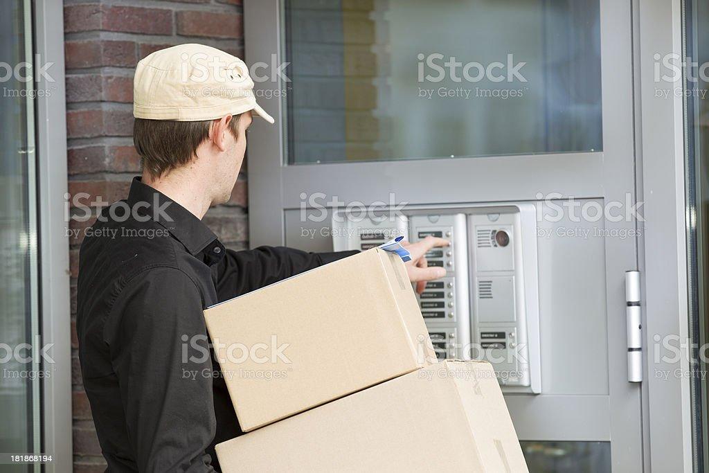Man giving box and looking at person.