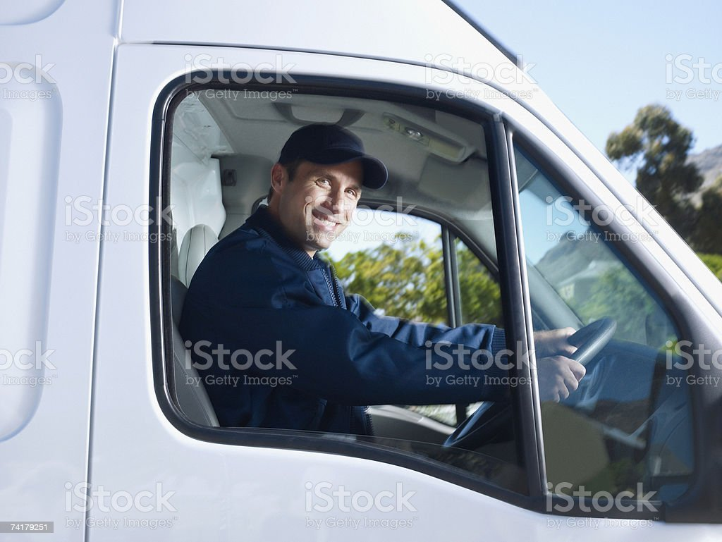 Delivery person driving van royalty-free stock photo