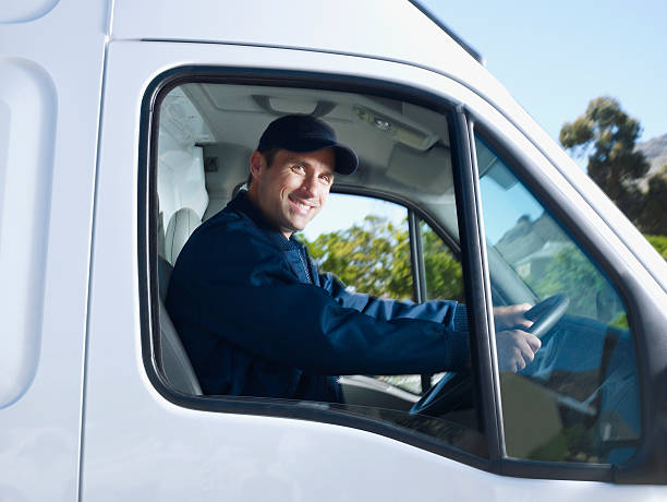 Delivery person driving van  commercial land vehicle stock pictures, royalty-free photos & images