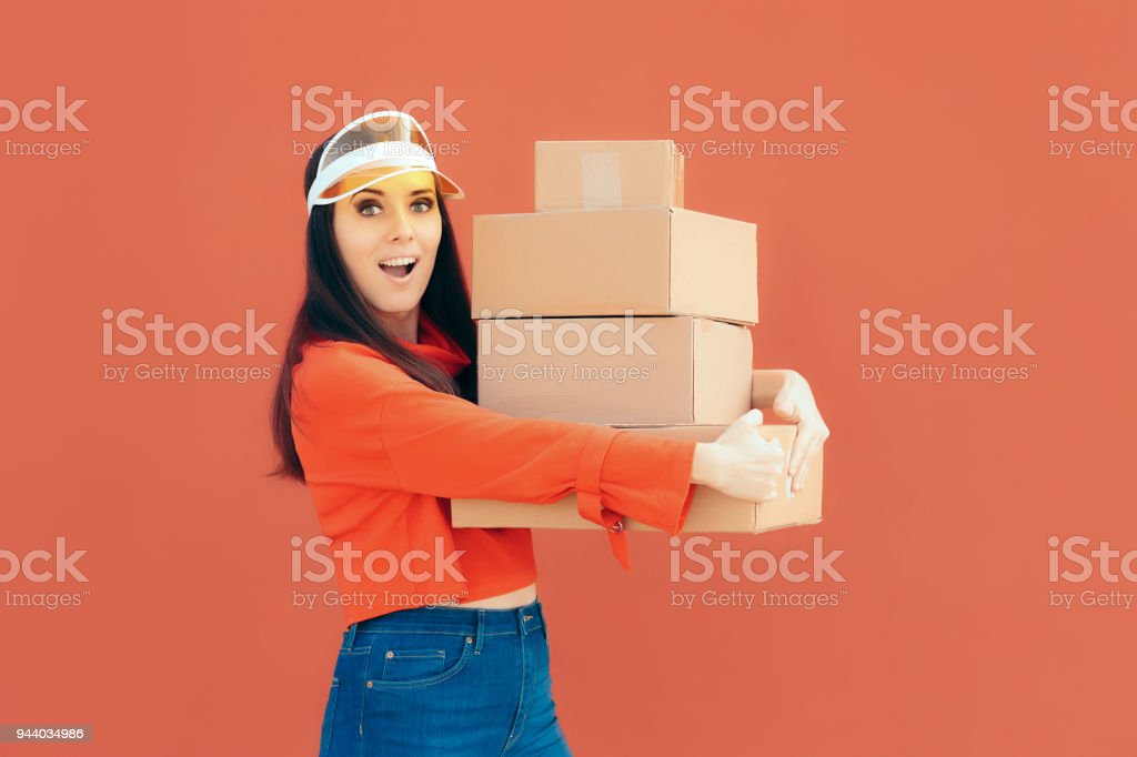 Female employee holding parcels for shipment