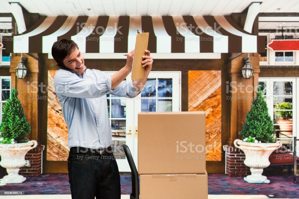 Delivery person in front of small business
