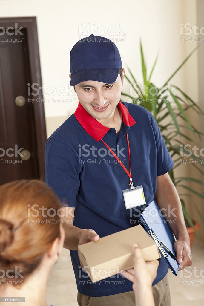 Delivery person is delivering package.