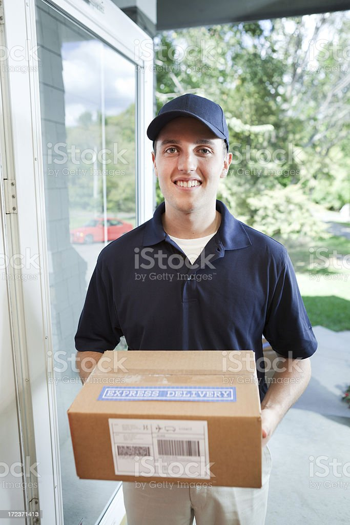 Delivery Service at Customer's Door Delivering a Package Vt stock photo