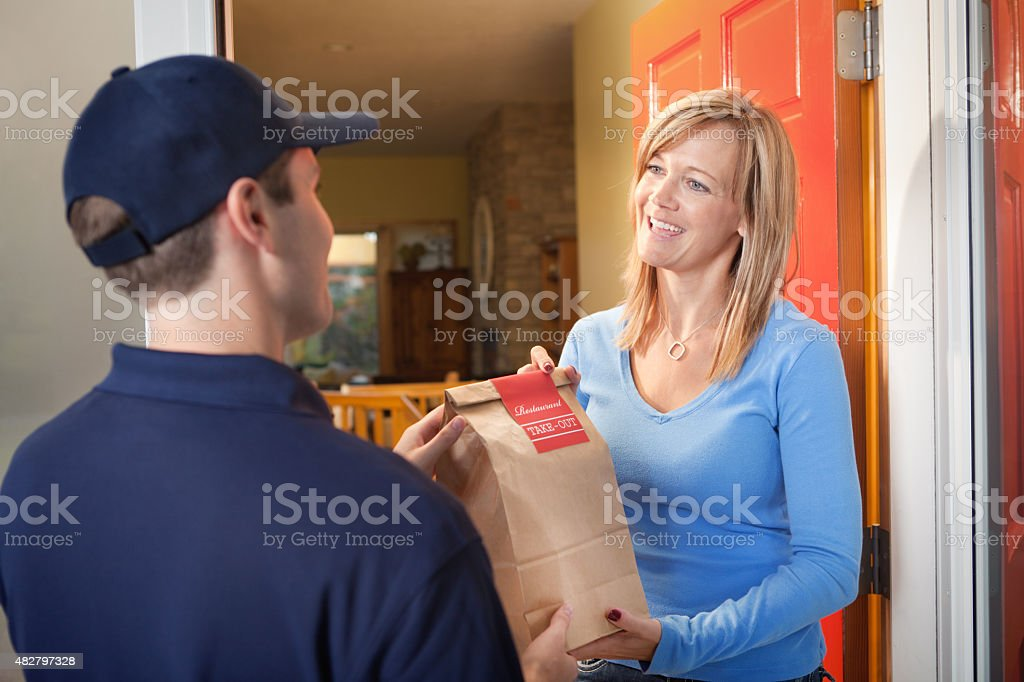 Delivery Service Man Delivering Take-out Food Bag to Customer Door stock photo