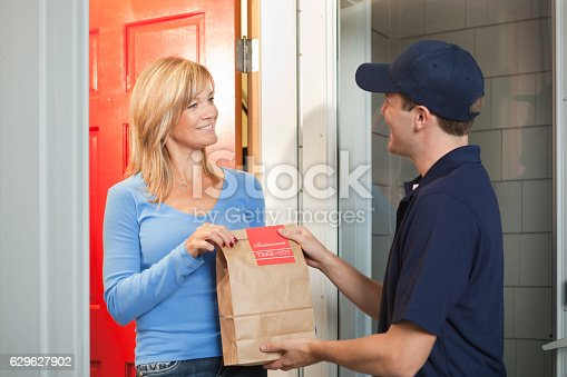Delivery Service Man Delivering Takeout Food Bag To