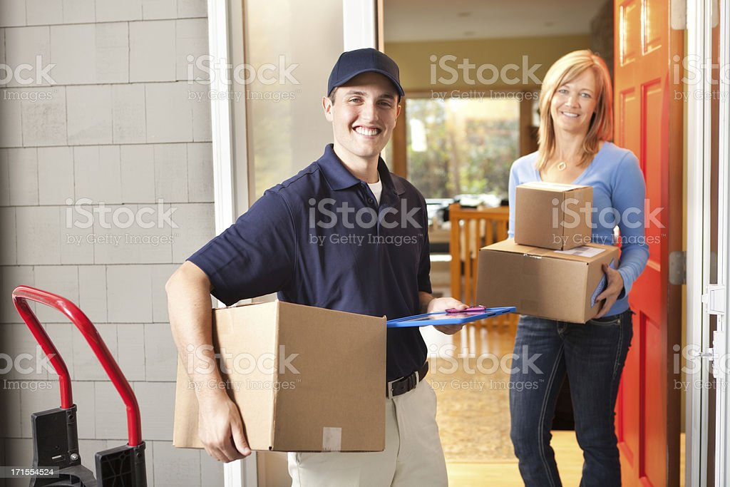 Delivery Service Man Deliverying Packages to Customer Hz stock photo