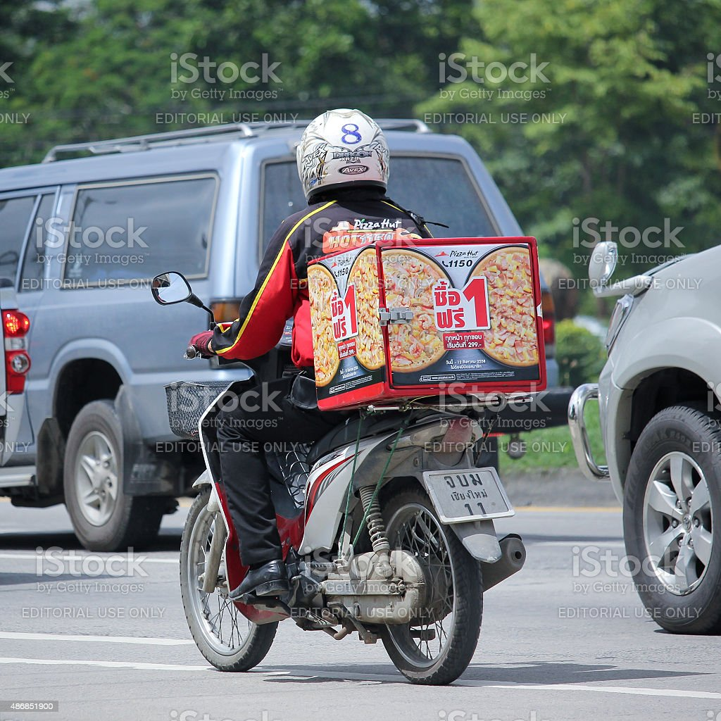 Delivery service man ride a Motercycle of Pizza Hut Company stock photo