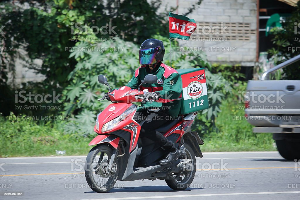 Delivery service man ride a Motercycle stock photo