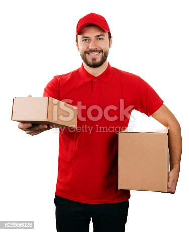 istock delivery service - young smiling courier holding boxes 629956026