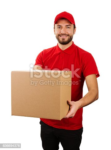 istock delivery service - young smiling courier holding cardboard box 636694376