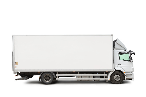 A white truck isolated on white background, includes clipping path.