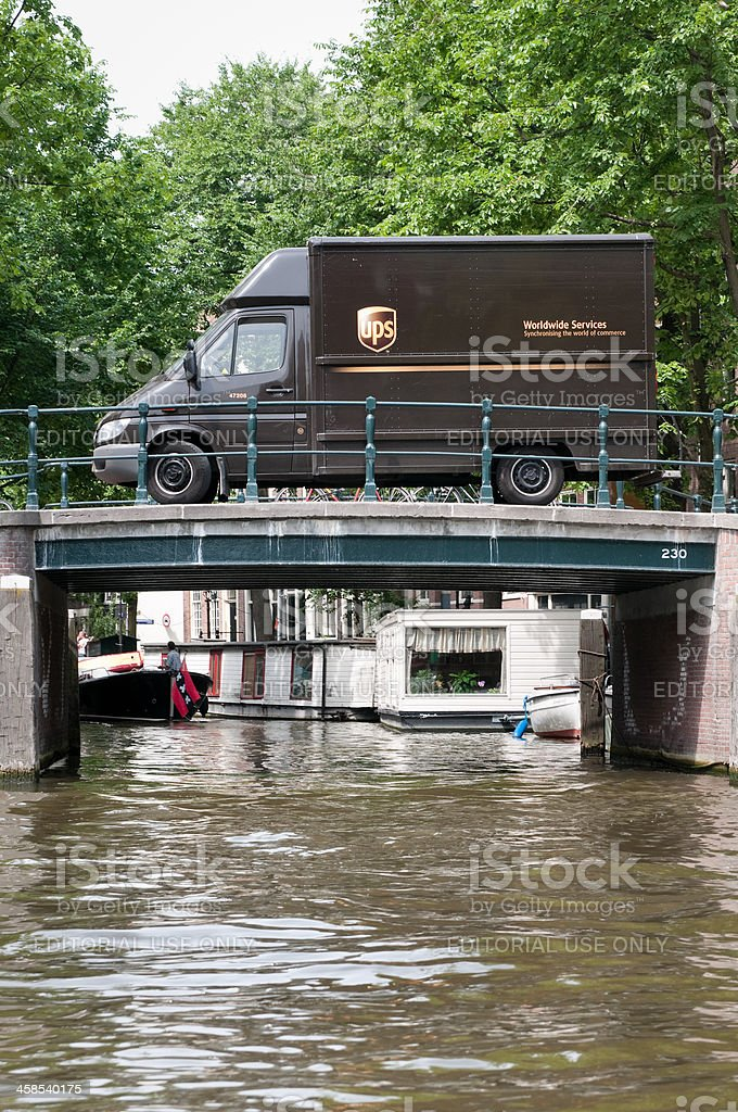 Ups Delivery Truck On Amsterdam Canal Bridges Stock Photo