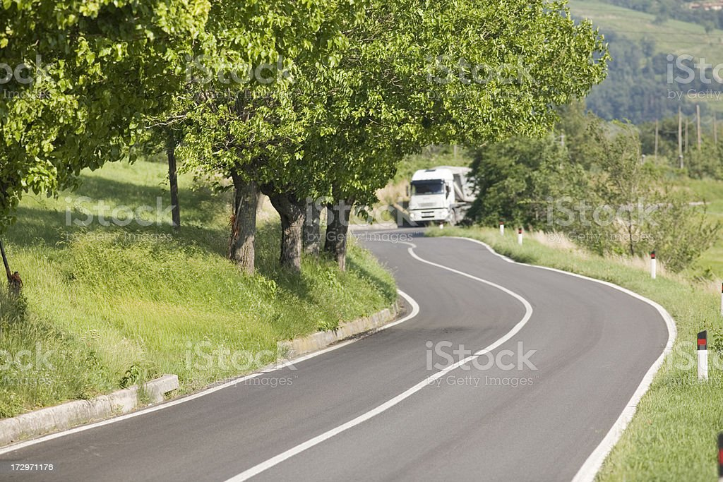 Delivery truck on small road. royalty-free stock photo