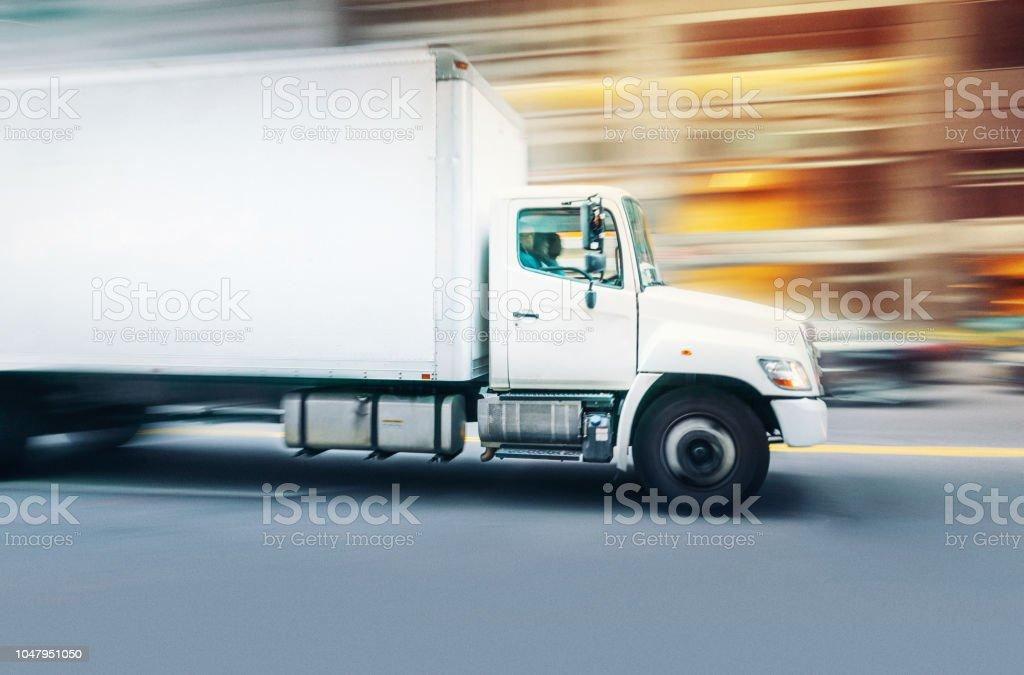 Delivery truck speeding in New York stock photo