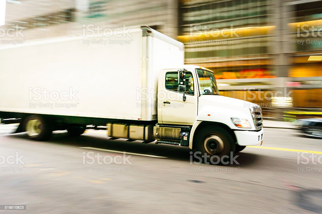 Delivery truck speeding in New York stock photo